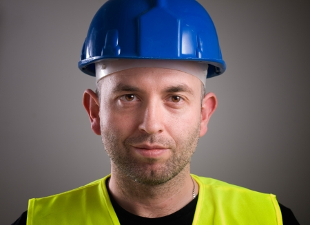 Worker man portrait isolated on dark background photo