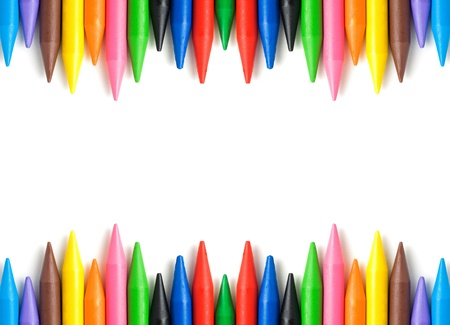 Wax crayons frame isolated on white background with copy space. photo