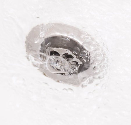 sink hole: Plughole with water in square composition Stock Photo