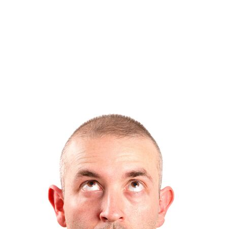 Caucasian man looking up with copy space and isolated on white background photo