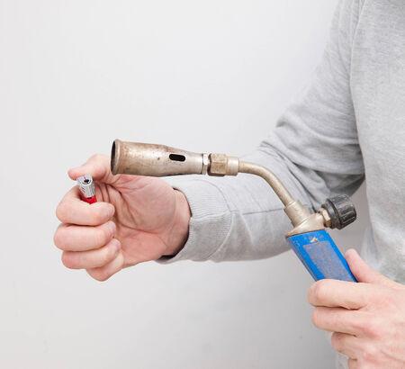 gas lighter: Man lighting a gas burner with a lighter