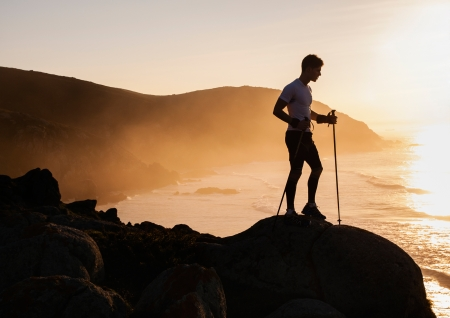 silhouette of an athlete who practice trail running.  photo