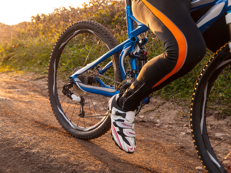 Mountain bike detail outdoors with a leg biker photo