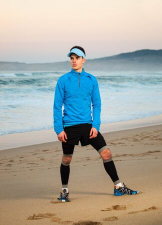 strobist: Athlete standing on the beach. The man is an athlete who practice trail running.