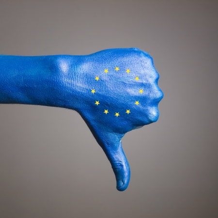 expressing negativity: Hand painted with the flag of European Community and expressing negativity and isolated on gray background Stock Photo
