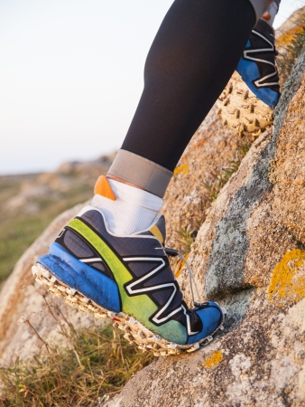 Extreme sports shoes for trail running practice in nature.