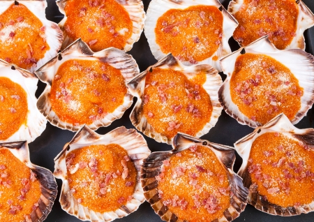 Baked scallops background. A delicious meal from Galicia, Spain. Stock Photo
