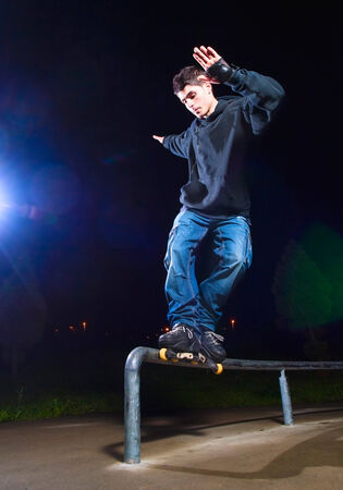 inline skating: Young man practicing rollerskating. The young is grind a railing. Stock Photo