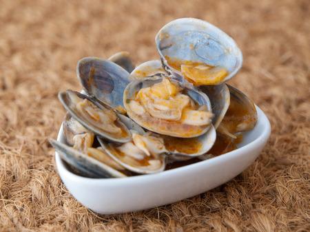 almejas: Clams cooked in the recipe almejas a la marinera in a studio shot