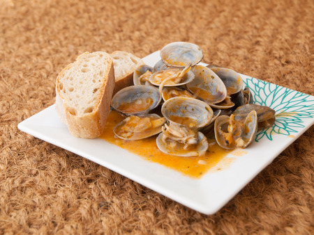almejas: Clams cooked in the recipe almejas a la marinera background  Stock Photo