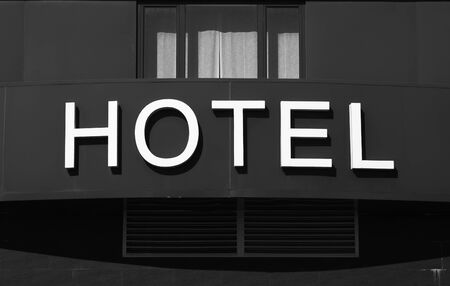 Hotel word in the facade of a Hotel outdoors photo