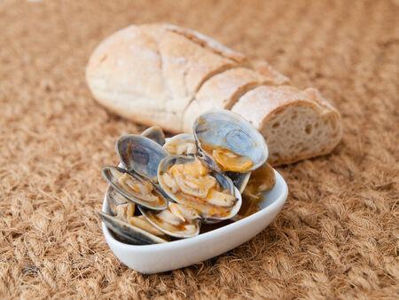 almejas: Clams cooked in the recipe almejas a la marinera background in a studio shot