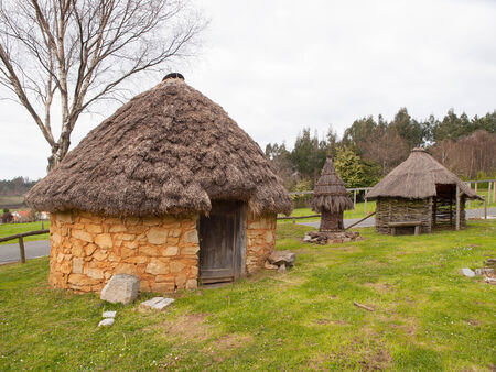 Small pallozas outdoors in Galicia, Spain. Stock Photo