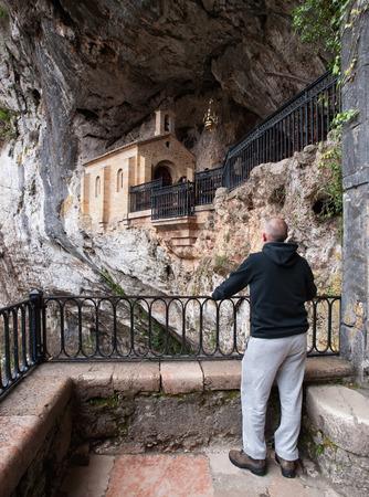 covadonga: Man looking Covadonga chapel in Asturias, Spain.