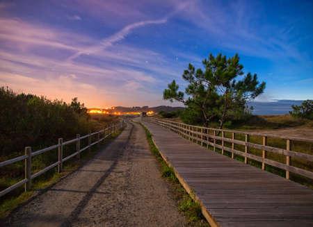 boardwalk trail: Wooden boardwalk and trail in the night in Ferrol, Galicia, Spain.