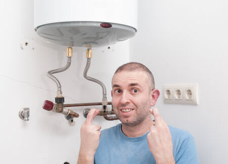 hoping: Plumber home hoping to get lucky with the installation of electric heat Stock Photo