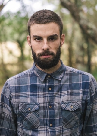 man with beard: Hipster man portrait outdoors. Man is looking at camera.