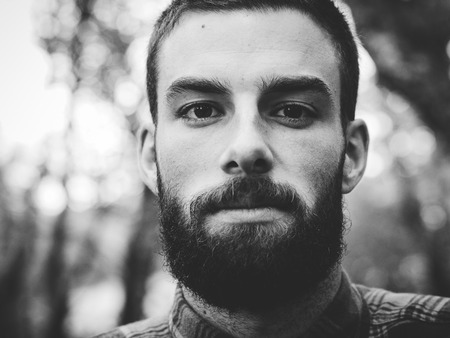 Hipster man portrait  in black and white in horizontal composition. photo