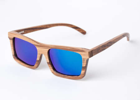isolated white: Wooden sunglasses isolated on white background in a studio shot.