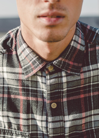 man mouth: Plaid shirt detail in the neck of a man Stock Photo