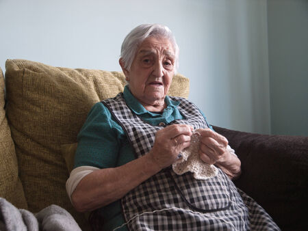 80 90: Elderly woman sewing at home