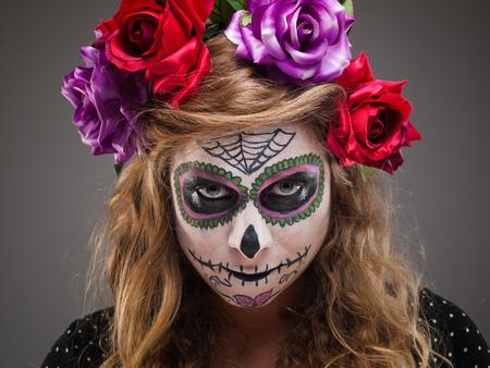 Beautiful woman wearing santa muerte mask portrait in a studio shot. photo