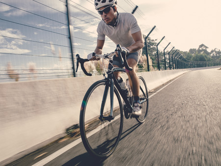 Cyclist on a road outdoors Stock Photo