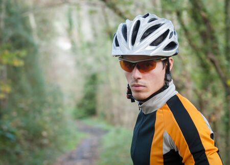 Cyclist portrait in a path of the forest Stock Photo