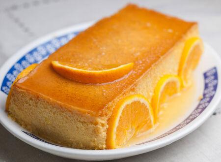 custard slices: Orange custard in a studio shot. A delicious dessert. Stock Photo