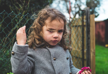 wild hair: Small girl with wild hair in the wind. Stock Photo