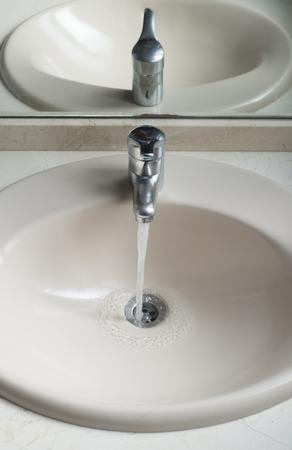 working water tap in a bathroom. Bathroom detail. photo