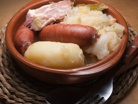 galician: Galician stew, a typical Spanish dish with potatoes, chickpeas, cabbage and bacon.