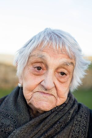 resignation: Elderly woman portrait with resignation expression Stock Photo