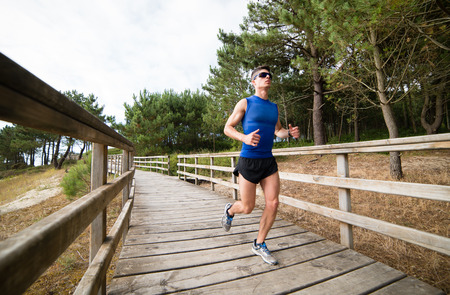 Man running in a promenade outdoors. Man is training Stock Photo