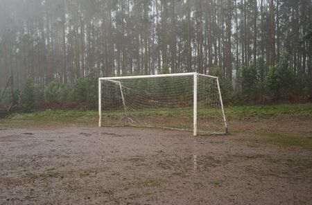 muddy: Muddy soccer field in the middle of a winter storm Stock Photo