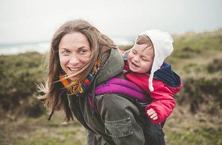 laughing: Mother laughing and having fun with your toddler outdoors