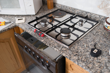 hobs: Gas hob and oven in a kitchen, Spain. Stock Photo