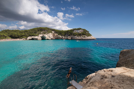 menorca: Cala mitjaneta and cala Mitjana in a sunny summer day, Menorca, Spain.