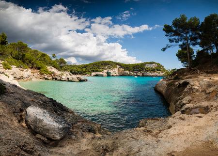 Cala Mitjaneta and cala Mitjana in a sunny summer day, Menorca, Spain. Stock Photo