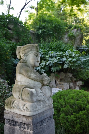 The sculpture of the god in a park in Shanghai, China