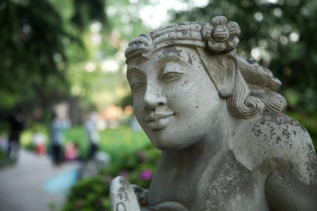 Stone statue of a god in a park in Shanghai, China Banque d'images