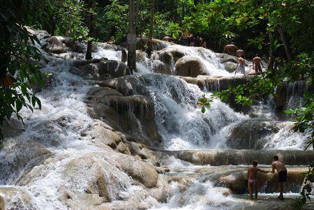 Walking inside Dunn's River Fall - a popular atraction in Ocho Rios, Jamaica.
