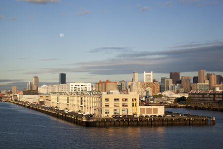The morning view of cruise ship terminal with Boston city skyline in a background (Massachusetts). Imagens