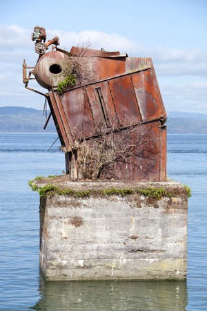 The unidentified rusty object left behind in Columbia River (Astoria, Oregon).