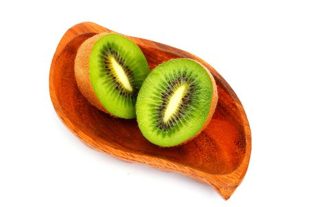 national fruit of china: Kiwi fruit on a wooden plate. Isolation  on a white background                               Stock Photo