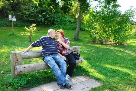 Happy elderly couple talking in the park Stock Photo - 6683935