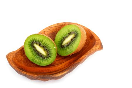 national fruit of china: Kiwi fruit on a wooden plate. Isolation on a white background