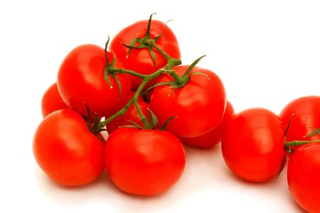 A few red tomatoes isolated on white                                Stock Photo
