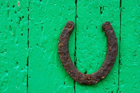 The old horseshoe on the old door                              photo