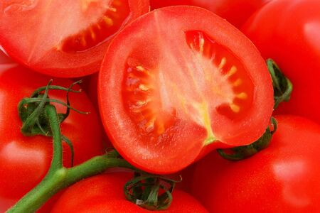 Ripe red  tomatoes on a green twig                                Stock Photo